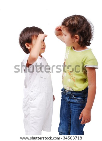 Two children measuring their height - stock photo