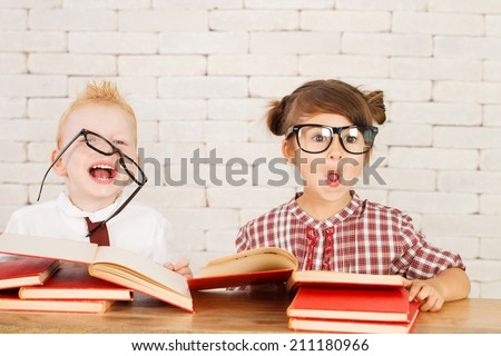 Two children nerds are perplexed and thinking. - stock photo