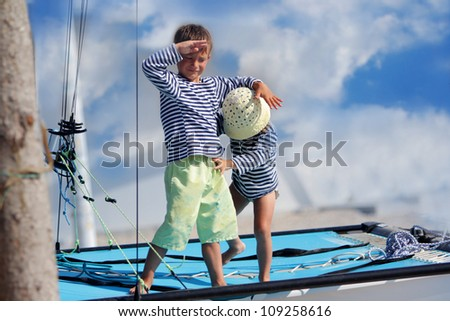 two children on board of sea yacht - stock photo
