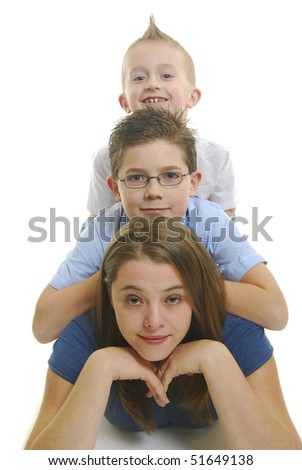Two children on mothers back isolated on white. - stock photo