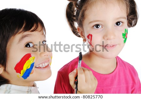 Two children painting on faces of each other - stock photo