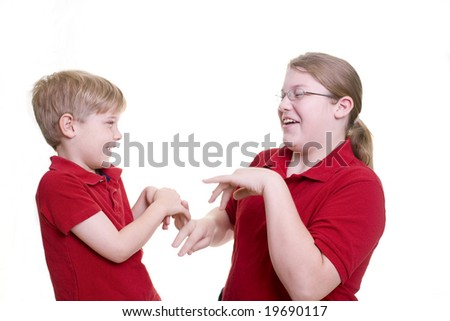 Two children playing a slapping game