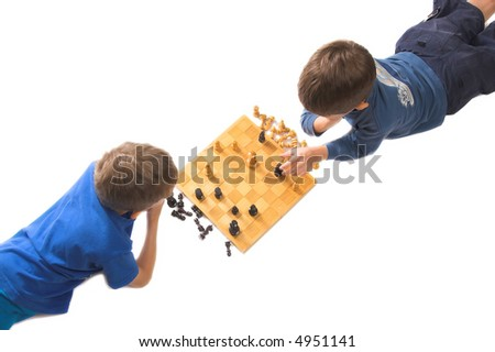 two children playing chess isolated over white, pieces in checkmate position - stock photo