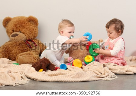 Two children playing educational games