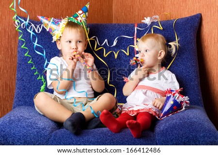 two children whistling - stock photo