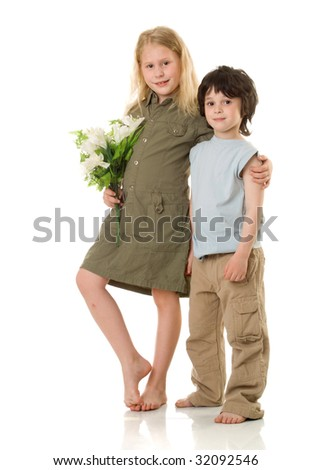 Two children with flowers - stock photo