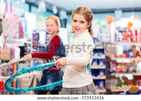 Two children with hula hoop in toy store playing - stock photo