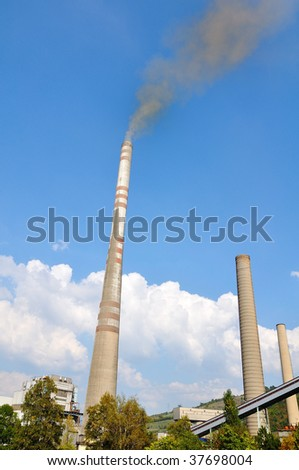 Two chimneys, industry, smoke against sky - stock photo