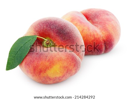 Two chinese flat donut peaches with leaf isolated on white with clipping path - stock photo