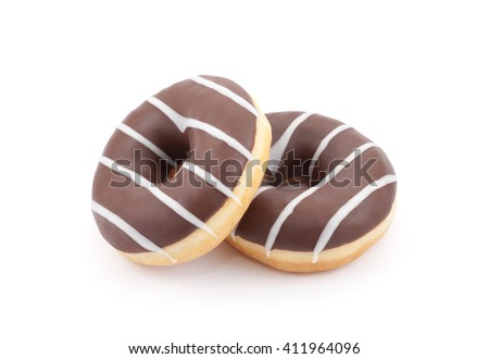 Two chocolate donuts isolated on white with clipping path  - stock photo