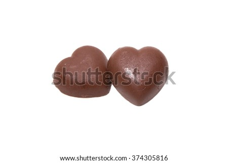 Two chocolate heart on white background - stock photo