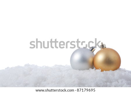 two christmas balls in snow over white background - stock photo