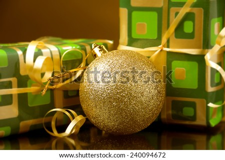 Two Christmas gift boxes and golden ball-Christmas decoration - stock photo