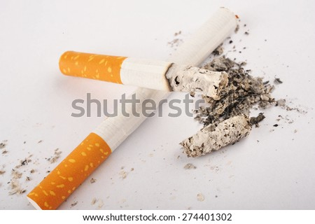 Two cigarettes, one is lit - stock photo
