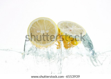 two citrons jumping out of the water