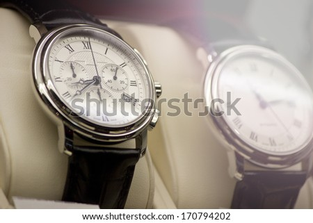 Two classic men's steel wrist watches - stock photo