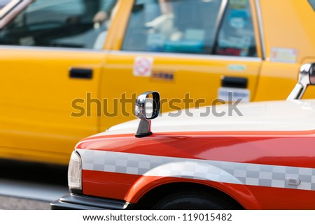 Two classic Tokyo taxis at rush hour in downtown Tokyo/Japan. - stock photo