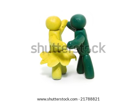 Two clay figures dancing on white background - stock photo