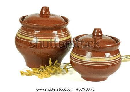 Two clay pots and rye ears - stock photo