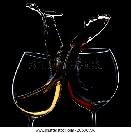 Two clincking glasses with red and white wine. Very high resolution. - stock photo