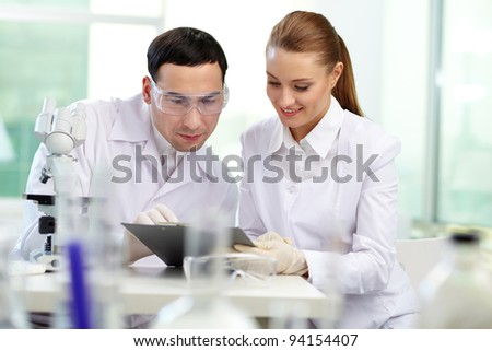 Two clinicians working in laboratory - stock photo