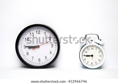 Two clocks isolated on white background