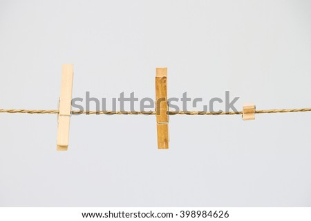 Two clothespin on the rope - stock photo