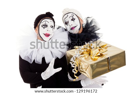 two clowns with a golden present - stock photo