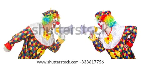 Two clowns with loudspeakers isolated on white - stock photo