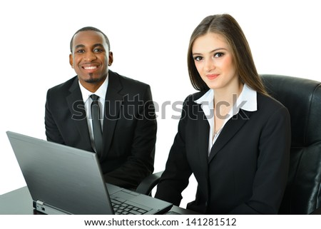 Two Co-Workers sitting and working - stock photo