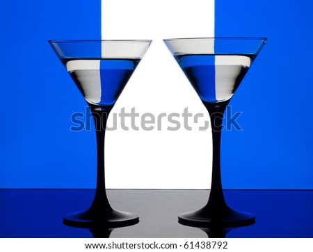 Two cocktails on a blue, white and blue background - stock photo