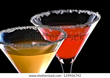 Two cocktails on black background - stock photo