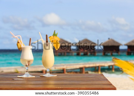 Two cocktails on luxury beach resort - stock photo