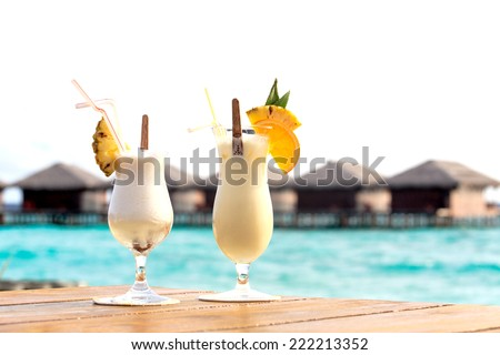 Two cocktails on tropical beach vacation in Maldives - stock photo