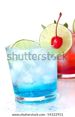 Two cocktails with lime slice and maraschino. Isolated on white background - stock photo