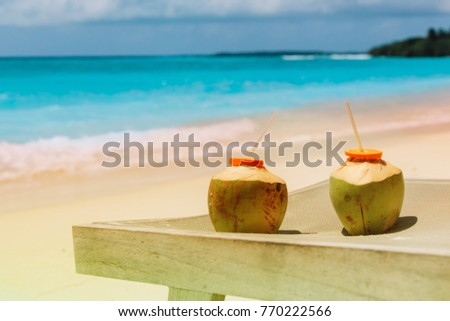 Two Coconut Drinks On Tropical Beach
