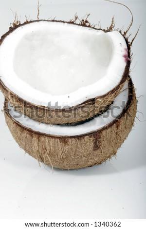 Two coconut halves - stock photo