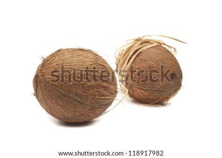 Two coconuts with bow isolatd on white background - stock photo