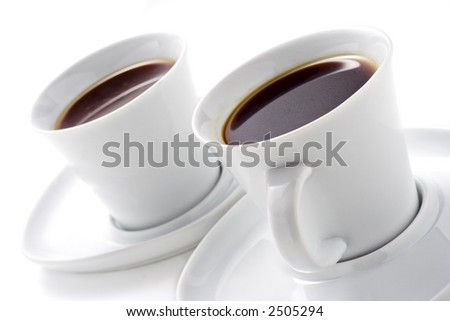 Two coffee cups against white background - stock photo