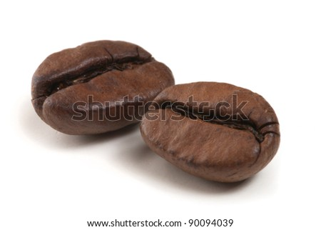 two coffee grains on white background - stock photo