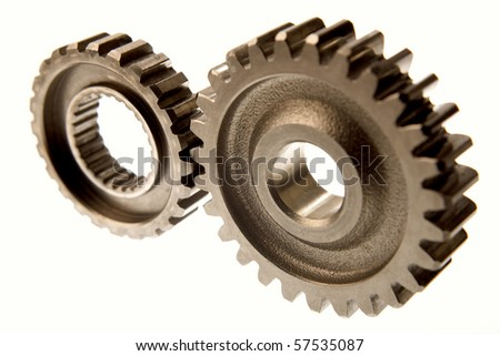 Two cogs connecting over white - stock photo