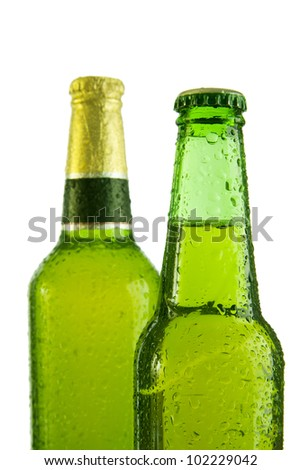 Two cold beers in green bottle isolated on white. Soft shadow