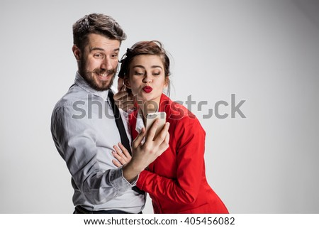 Two colleagues friends taking selfie with telephone camera  - stock photo