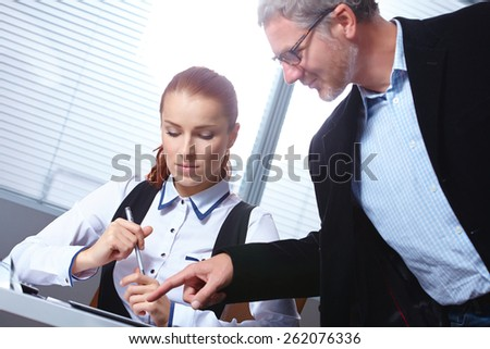 two colleagues in the office - stock photo