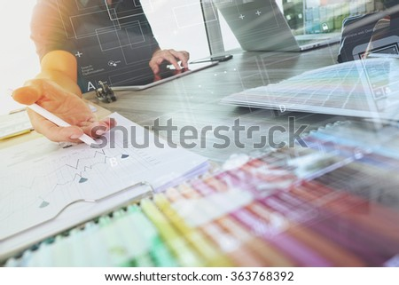 two colleagues interior designer discussing data and digital tablet and computer laptop with sample material and digital design diagram on wooden desk as concept - stock photo