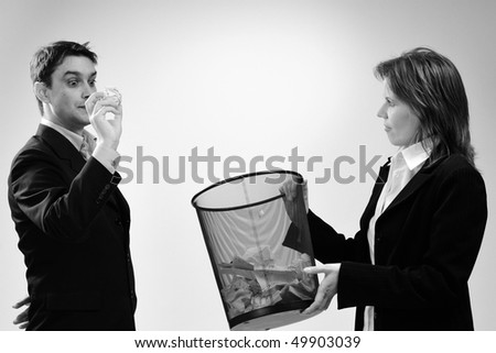 two colleagues relaxing in office - stock photo
