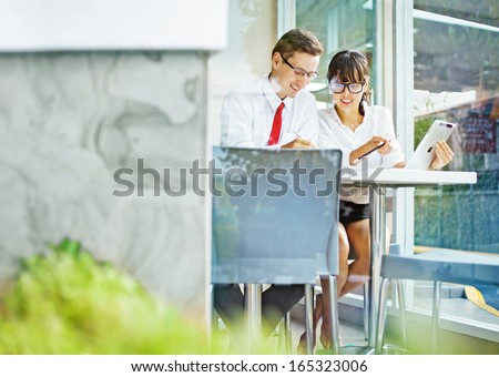 two colleagues working on project together  - stock photo