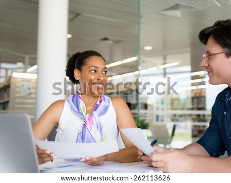 Two collegues working together in a office