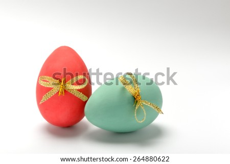 two colored Easter eggs on a white background - stock photo