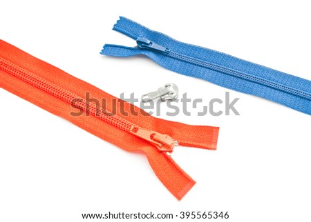 two colored zippers on white background closeup